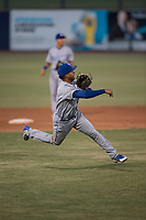 AZL Mariners third baseman Rubendy Jaquez (3) makes a throw to first base during an Arizona League game against the AZL Royals at Peoria Sports Complex on July 25, 2018 in Peoria, Arizona. The AZL Mariners defeated the AZL Royals 5-3. (Zachary Lucy/Four Seam Images)