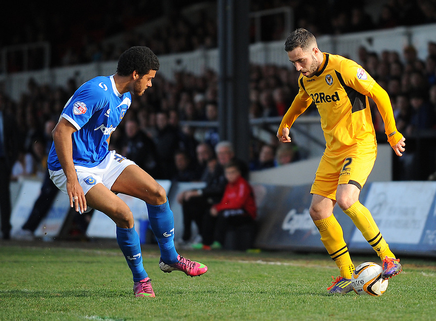 Newport County's Robbie Willmott under pressure from Portsmouth's Jake Jervis<br /> <br /> Photo by Kevin Barnes/CameraSport<br /> <br /> Football - The Football League Sky Bet League Two - Newport County AFC v Portsmouth - Saturday 29th March 2014 - Rodney Parade - Newport<br /> <br /> &copy; CameraSport - 43 Linden Ave. Countesthorpe. Leicester. England. LE8 5PG - Tel: +44 (0) 116 277 4147 - admin@camerasport.com - www.camerasport.com