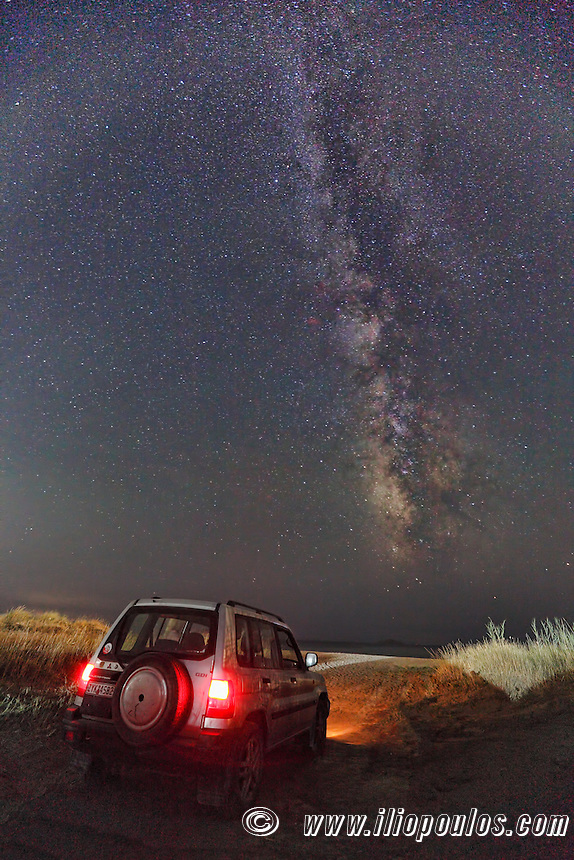 Night exploration with a Mitsubishi Pajero under the Milky Way