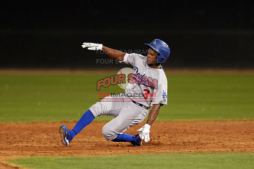 AZL Dodgers Lasorda Aldrich De Jongh (3) slides into second base during an Arizona League game against the AZL White Sox at Camelback Ranch on June 18, 2019 in Glendale, Arizona. AZL Dodgers Lasorda defeated AZL White Sox 7-3. (Zachary Lucy/Four Seam Images)