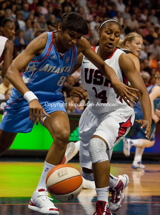 UNCASVILLE, CT 10  JULY, 2010-071010JS07-Team USA's Maya Moore (14) and WNBA All-Star Iziane Castro Marques (8) of the Atlanta Dream, battle for a loose ball durng their game Saturday at the Mohegan Sun Arena in Uncasville. <br /> Jim Shannon Republican-American
