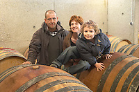 Marc and Sophie Valette with their son Camille Domaine de Canet-Valette Cessenon-sur-Orb St Chinian. Languedoc. Barrel cellar. Owner winemaker. France. Europe.