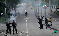 MEDELLIN, COLOMBIA - OCTOBER 24 Members of the Mobile Anti-Disturbance Squadron (ESMAD) fire tear gas during a students protest in Medellin, Colombia, on October 24, 2019. Regional elections will take place on October 27 in Colombia. (Photo by Fredy Builes/VIEWpress)