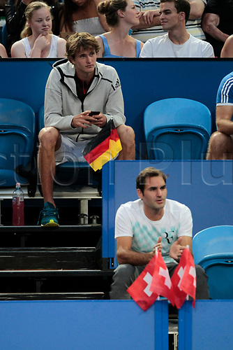 6th January 2018, Perth Arena, Perth, Australia; MasterCard Hopman Cup Tennis Final; Roger Federer of Team Switzerland and Alexander Zverev of Team Germany watch the womens Final between Angelique Kerber of Team Germany and Belinda Bencic of Team Switzerland Kerber won 2 sets to 0