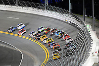 12-13 February, 2016, Daytona Beach, Florida, USA<br /> Jimmie Johnson and Brad Keselowski lead the field into the first turn on lap one.<br /> ©2016, F. Peirce Williams