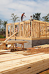 Construction workers build what will be Amanda Porter's home in Vaughn, Georgia August 12, 2011. In April, Vaughn was hit by a tornado that destroyed many homes in the area. Months later, the community is still picking up the pieces.