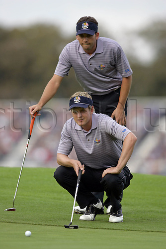 23 September 2006: European players Luke Donald and Sergio Garcia line up a putt on the 15th green during the second day of The 2006 Ryder Cup played at The K Club, Straffan, County Kildare, Ireland. Garcia and Donald won the match 2 & 1 Photo: Glyn Kirk/Actionplus...060923 golf golfer teamwork