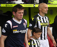 Teams captains Richie Brittain (left) and Jim Goodwin lead their teams out in the St Mirren v Ross County Scottish Professional Football League Premiership match played at St Mirren Park, Paisley on 3.5.14.