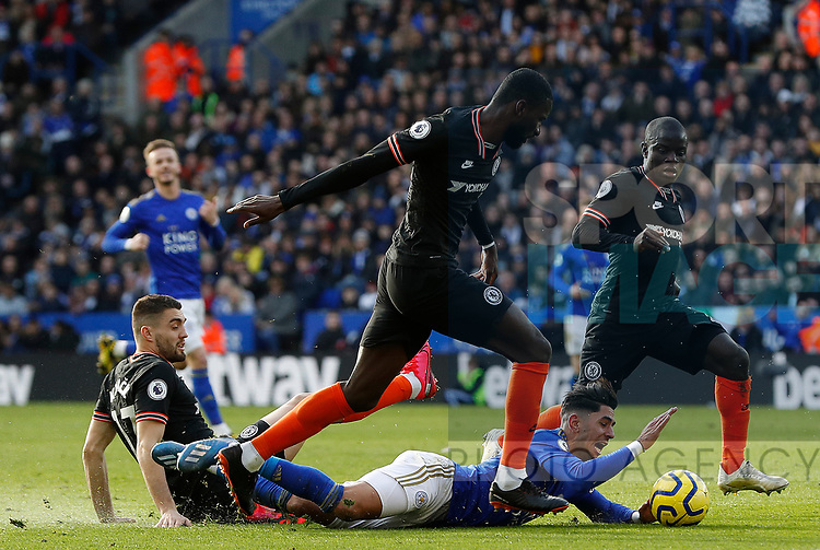 Ayoze Perez of Leicester City is challenged by Mateo Kovacic, Antonio Rudiger and N'Golo Kante of Chelsea during the Premier League match at the King Power Stadium, Leicester. Picture date: 1st February 2020. Picture credit should read: Darren Staples/Sportimage