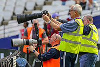 Photographers during the Premier League match between West Ham United and Manchester City at the London Stadium, London, England on 10 August 2019. Photo by David Horn.