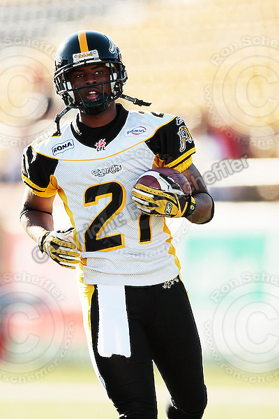 Aug 3, 2007; Hamilton, ON, CAN; Winnipeg Blue Bombers play the Hamilton Tiger-Cats at Ivor Wynne Stadium. The Tiger-Cats defeated the Blue Bombers 43-22. Mandatory Credit: Ron Scheffler. Pictured here is Hamilton Tiger-Cats defensive back (21) Sir James Delgardo.
