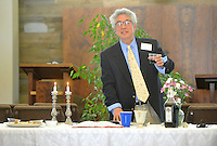 NWA Democrat-Gazette/MICHAEL WOODS &bull; @NWAMICHAELW<br /> Daniel Levine, a member of Temple Shalom of Northwest Arkansas, raises the first cup of wine as he leads the community Passover Seder on Saturday, April 23, 2016, in Fayetteville.  Four cups of wine are drunk as part of the Seder as one of the many symbols of freedom throughout the service.