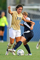 27 August 2011:  FIU's Kelly Ann Hutchinson (12) is tripped by Akron's Ashley Hughes (7) in the first half as the FIU Golden Panthers defeated the University of Arkon Zips, 1-0, at University Park Stadium in Miami, Florida.