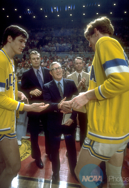 25 MAR 1972:  UCLA coach John Wooden shakes hands with center Bill Walton (32) after the NCAA Men's National Basketball Final Four championship game against Florida State held in Los Angeles, CA at the Sports Arena. UCLA defeated Florida State 81-76 for the title. Walton was named MVP. Photo by Rich Clarkson/NCAA PhotosSI CD1647-02