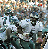 Ashburn, VA - April 4, 2010 -- The Washington Redskins announced they have traded 2 draft choices for long-time Philadelphia Eagles quarterback Donovan McNabb.  In this file photo from October 5, 2003, McNabb (5) hands off to RB Brian Westbrook (36) for a 4 yard gain in the first quarter against the Redskins at Lincoln Financial Field in Philadelphia, Pennsylvania. The Eagles won 27-25 for their first victory in the new Lincoln Financial Field. .Credit: Arnie Sachs / CNP