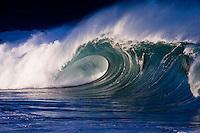 Beautiful large wave cresting at the shore break of Waimea Bay on the island of Oahu, Hawaii.