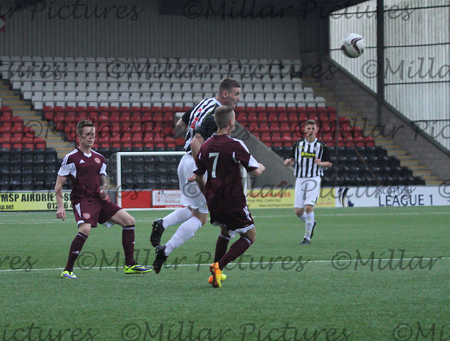 Jason Naismith heads the ball in the St Mirren v Heart of Midlothian Scottish Professional Football League Under 20 match played at Excelsior Stadium, Airdrie on 1.10.13.