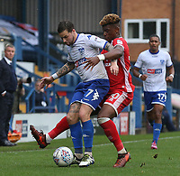 Bury's Chris Maguire under pressure from Milton Keynes Dons' Aaron Tshibola<br /> <br /> Photographer Juel Miah/CameraSport<br /> <br /> The EFL Sky Bet League One - Bury v Milton Keynes Dons - Saturday 30th September 2017 - Gigg Lane - Bury<br /> <br /> World Copyright &copy; 2017 CameraSport. All rights reserved. 43 Linden Ave. Countesthorpe. Leicester. England. LE8 5PG - Tel: +44 (0) 116 277 4147 - admin@camerasport.com - www.camerasport.com