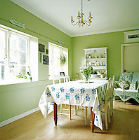 The bright and sunny breakfast room is painted in Farrow & Ball's Cooking Apple Green