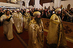 Egyptian Coptic Christians attend the Coptic Christmas Eve mass at the Saint Mark's Coptic Orthodox Cathedral in Cairo, capital of Egypt, on Jan 6, 2015. Coptic Pope Tawadros II, head of Coptic Orthodox Church led the mass on the night of Tuesday, which was attended by thousands of Egyptian Coptic Christians. Photo by Amr Sayed