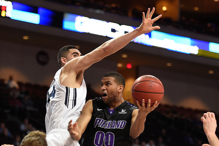 March 9, 2015; Las Vegas, NV, USA; Portland Pilots guard Kevin Bailey (00) shoots the basketball against Brigham Young Cougars center Corbin Kaufusi (44) during the second half of the WCC Basketball Championships at Orleans Arena.