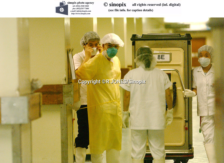 Doctors prepare to take equipment to the incubation ward at Prince of Wales Hospital in Hong Kong, which is the center of the new Asian flu epidemic which has spread to severeal counries around the world.