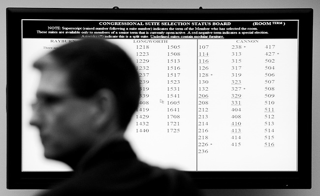Framed by the display of available office suites, Rep. elect Joe Heck, R-Nev., waits to select his new office during the House office lottery for the newly elected members of Congress on Nov. 19, 2010. (Photo By Bill Clark/Roll Call)