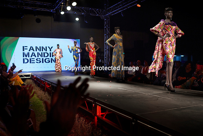 KINSHASA, DRC - JULY 18: Models walk for the designer Fanny Mandina Designs at Kinshasa Fashion Week on July 18, 2014, at Shark club in Kinshasa, DRC. Local and invited foreign-based designers showed their collections during the second edition of Kinshasa Fashion week. Model Vanessa Nsul Kilem, age 21, walks in front. (Photo by Per-Anders Pettersson)