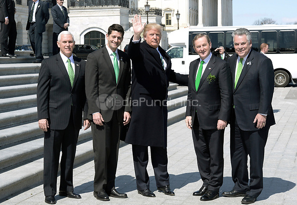 U.S. President Donald J. Trump (3-L) flanked by House Speaker Paul Ryan(2-L), Congressman Peter King (R) ,the Taoiseach of Ireland Enda Kenny (4-R)  and Vice President Mike Pence(L) pose outside the Capitol after attending the Friends of Ireland Luncheon at the U.S Capitol on March 16, 2017 in Washington, DC. Photo by Olivier Douliery/ SipaUSA /MediaPunch