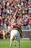 November 6, 2010:    Florida State Seminoles mascot Chief Osceola throws his spear to start the Atlantic Coast Conference action between the Florida State Seminoles and the University of North Carolina Tar Heels at Doak Campbell Stadium in Tallahassee, Florida.   North Carolina defeated Florida State 37-35.