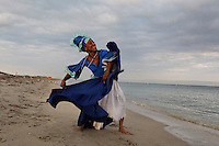 Marisol Blanco dancing the Yemaya on the beach at Bill Baggs State Park. The color of her outfit symbolizes water--and it gives life to all things. ..