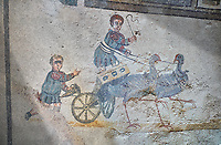 Close up picture of the Roman mosaics of the room of the Small Circus depicting Roman boys riding small chariots pulled by birds in a small circus, The Vestibule of The Smnall Circus, room no 41  at the Villa Romana del Casale, first quarter of the 4th century AD. Sicily, Italy. A UNESCO World Heritage Site.<br /> <br /> The Roman mosaic know as the Small Circus at the Villa Romana del Casale depicts a scene of a chariot race from the Circus Maximus in Rome. Two wheeled chariots, driven by children,  are racing around a central Pina (barrier) being drawn by fowl and web footed birds. The four chariots represent the four factions that raced against each other at the Circus and the tunics of the cild charioteers and the birds pulling their chariots are distinguished by the four different colours used by each faction.