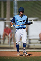Jake Holland during the WWBA World Championship at the Roger Dean Complex on October 20, 2018 in Jupiter, Florida.  Jake Holland is a catcher from Clermont, Florida who attends Montverde Academy and is committed to Georgia Tech.  (Mike Janes/Four Seam Images)
