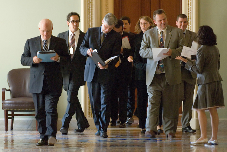 From left, Ben Cardin, D-Md., Sheldon Whitehouse, D-R.I., and John Tester, D-Mont., lead a procession of freshman Democratic Senators and staffers through the Ohio Clock Corridor to their news conference on Wednesday, July 25, 2007, to discuss efforts to enact ethics and lobbying reform legislation before the August recess. Also attending the event were Sen. Amy Klobuchar, D-Minn., Sen. Bernie Sanders, I-Vt., Sen. Sherrod Brown, D-Ohio, Sen. Bob Casey, D-Pa., Sen. Jim Webb, D-Va, and Sen. Claire McCaskill, D-Mo.,