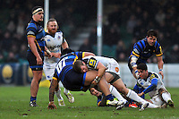 Jonathan Evans of Bath Rugby tackles Na'ama Leleimalefaga of Worcester Warriors to ground. Aviva Premiership match, between Worcester Warriors and Bath Rugby on February 13, 2016 at Sixways Stadium in Worcester, England. Photo by: Patrick Khachfe / Onside Images