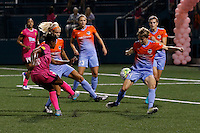 Western New York Flash defender Taylor Smith (11) shoots through a swarm of Houston Dash defenders