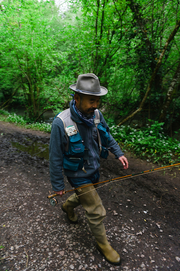 Fly fisherman Atsushi Hasegawa, Valiis Vale, Frome, UK, May 19, 2016. A designer, illustrator and DJ, as well as fly fishing expert, Hasegawa spent fifteeen years in Paris before eventually settling in the Somerset countryside. Weekdays he works as a designer for a globally-known shoe company. At the weekend he might be found by a bubbling stream sharing tips on casting technique and the ways of the wily local trout.