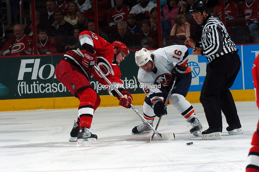 New York Islanders' Mike York (16) faces off with Carolina Hurricanes' Eric Staal, left, during their game Thursday, Jan. 19, 2006 in Raleigh, NC. Carolina won 4-3.
