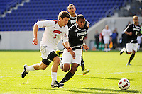Charlie Campbell (2) of the Louisville Cardinals and George Hodge (3) of the Providence Friars contest for a ball. The Louisville Cardinals defeated the Providence Friars 3-2 in penalty kicks after playing to a 1-1 tie during the finals of the Big East Men's Soccer Championship at Red Bull Arena in Harrison, NJ, on November 14, 2010.