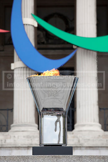 24/08/2012. LONDON, UK. The Trafalgar Square Paralympic cauldron is seen with the Paralympic Agitos in Trafalgar Square after being lit by disability campaigner Claire Lomas in London today (24/08/12). Photo credit: Matt Cetti-Roberts