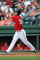 Right fielder Cole Sturgeon (35) of the Greenville Drive bats in a game against the Augusta GreenJackets on Friday, July 11, 2014, at Fluor Field at the West End in Greenville, South Carolina. Sturgeon is a tenth-round pick of the Boston Red Sox in the 2014 First-Year Player Draft out of the University of Louisville. Greenville won, 7-6. (Tom Priddy/Four Seam Images)