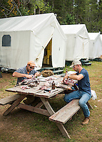 Outdoor Life Editor Andrew McKean and hunter Mike Stock cut and bag mule deer meat after hunting with Trefren Outfitters on Greyback Ridge in the Hoeback Drainage of Wyoming Region H, outside of Alpine, Wyoming, September 24, 2015.<br /> <br /> Photo by Matt Nager