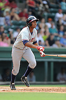 Third baseman Carlos Franco (11) of the Rome Braves bats in a game against the Greenville Drive on Sunday, August 3, 2014, at Fluor Field at the West End in Greenville, South Carolina. Rome won, 4-2. (Tom Priddy/Four Seam Images)