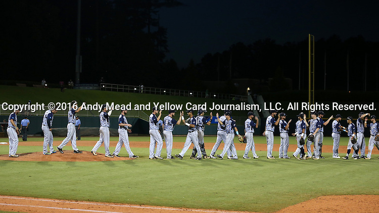 31 May 2016: Nova Southeastern players congratulate each other after the win. The Nova Southeastern University Sharks played the Lander University Bearcats in Game 8 of the 2016 NCAA Division II College World Series  at Coleman Field at the USA Baseball National Training Complex in Cary, North Carolina. Nova Southeastern won the game 12-1.