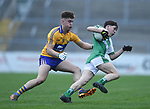 Adam O Connor of  Clare  in action against Brian Foley of  Limerick during their Munster Minor football quarter final at  Cusack Park. Photograph by John Kelly.