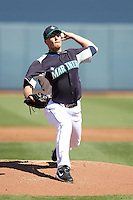 Lucas French #25 of the Seattle Mariners pitches in a spring training game against the San Diego Padres at Peoria Stadium on February 27, 2011  in Peoria, Arizona. .Photo by:  Bill Mitchell/Four Seam Images.