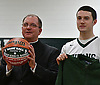 Newly-installed Diocese of Rockville Centre Bishop John Barres poses for pictures alongside Holy Trinity basketball captain Thornton Scott before a Nassau-Suffolk CHSAA varsity boys basketball game against St. John the Baptist at Holy Trinity High School on Friday, Feb. 3, 2017.