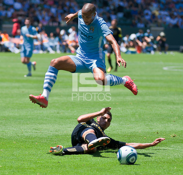 CARSON, CA – July 24, 2011: Gael Clichy (22) of Manchester City and Sean Franklin (5) of LA Galaxy during the match between LA Galaxy and Manchester City FC at the Home Depot Center in Carson, California. Final score Manchester City FC 1 and LA Galaxy 1. Manchester City wins shoot out 7, LA Galaxy 6.