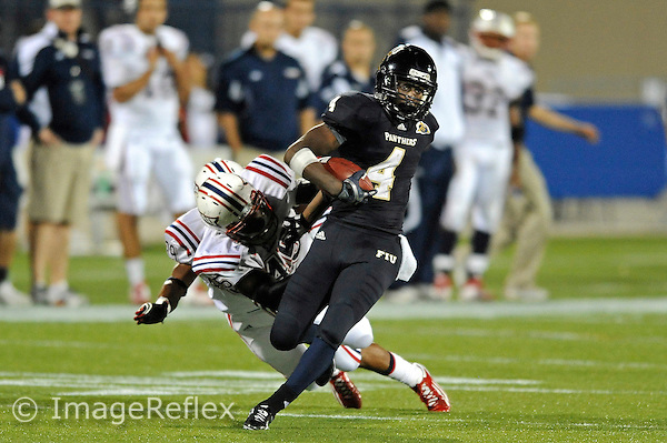 12 November 2011:  FIU wide receiver T.Y. Hilton (4) attempts to break away from Florida Atlantic linebacker Andrae Kirk (45) in the third quarter as the FIU Golden Panthers defeated the Florida Atlantic University Owls, 41-7, to win the annual Shula Bowl game, at FIU Stadium in Miami, Florida.