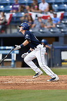 Asheville Tourists first baseman Tyler Nevin (23) swings at a pitch during a game against the Greenville Drive at McCormick Field on April 16, 2017 in Asheville, North Carolina. The Drive defeated the Tourists 4-2. (Tony Farlow/Four Seam Images)